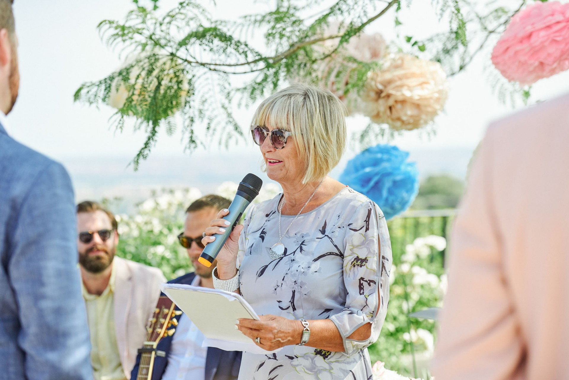 Mother of the bride giving a reading at a Italian destination wedding in Sicily