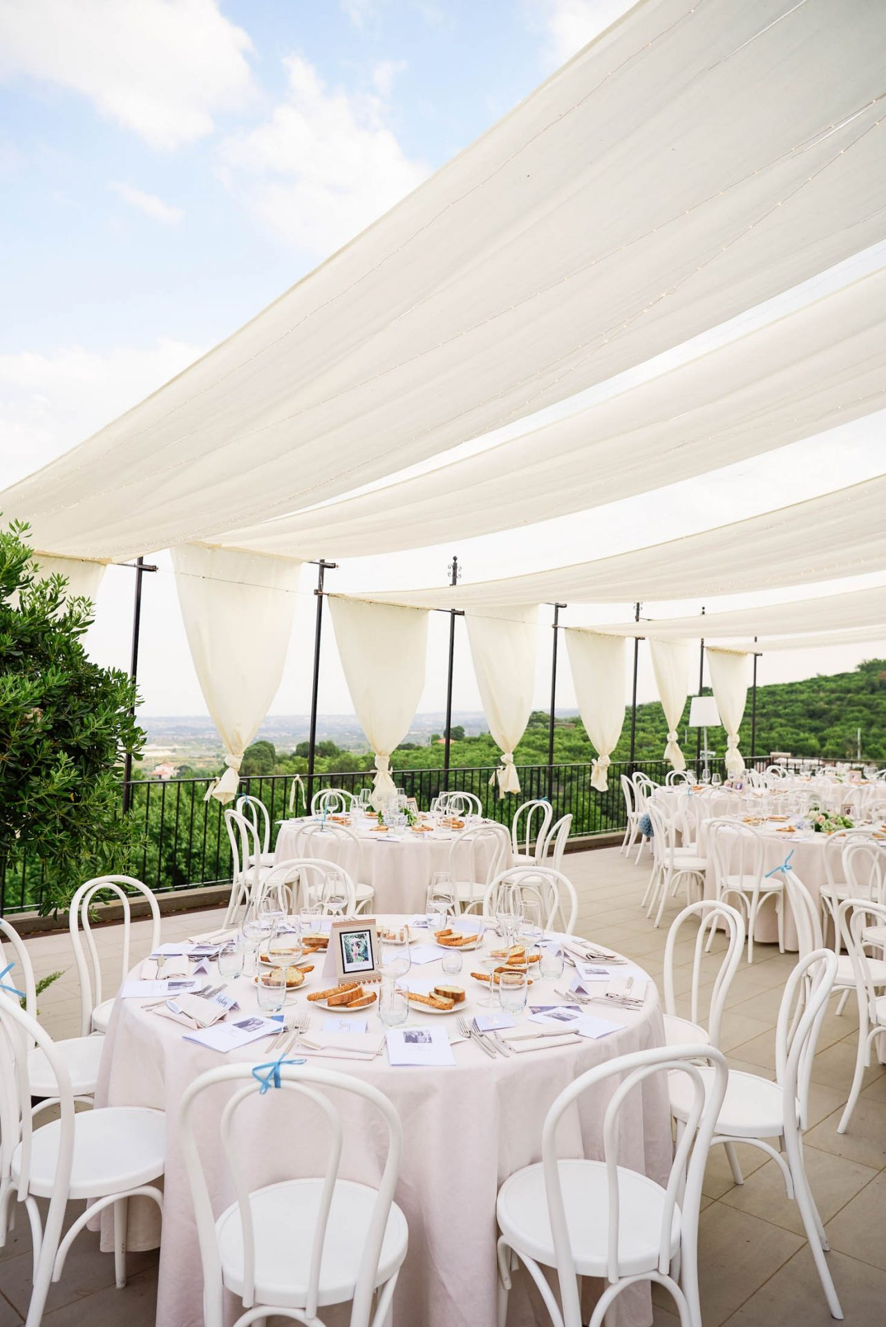 beautiful scenic view of Taormina with empty round table set up at the Talé Hotel in Sicily