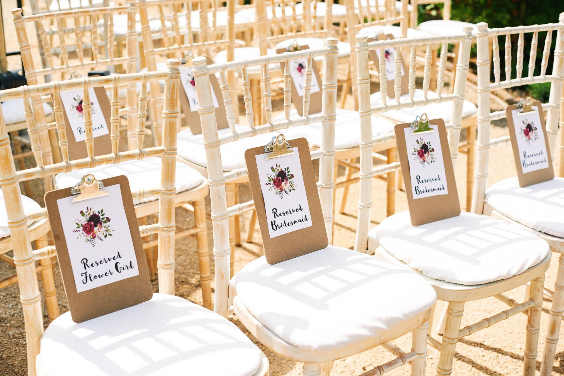 reserved seating clipboards on wooden wedding ceremony chairs