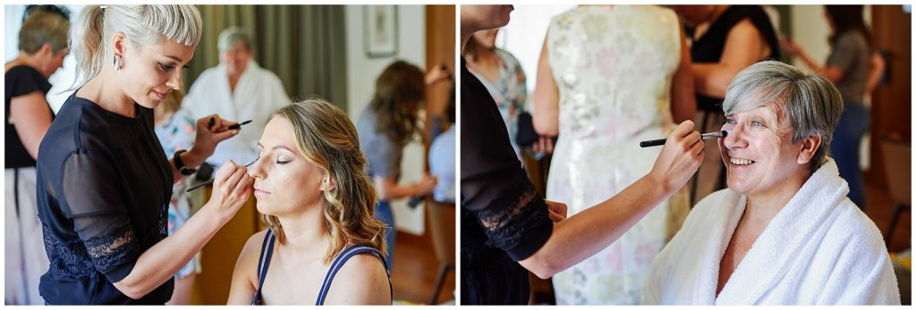 mother of the bride and bridesmaid having their wedding makeup done during bridal prep