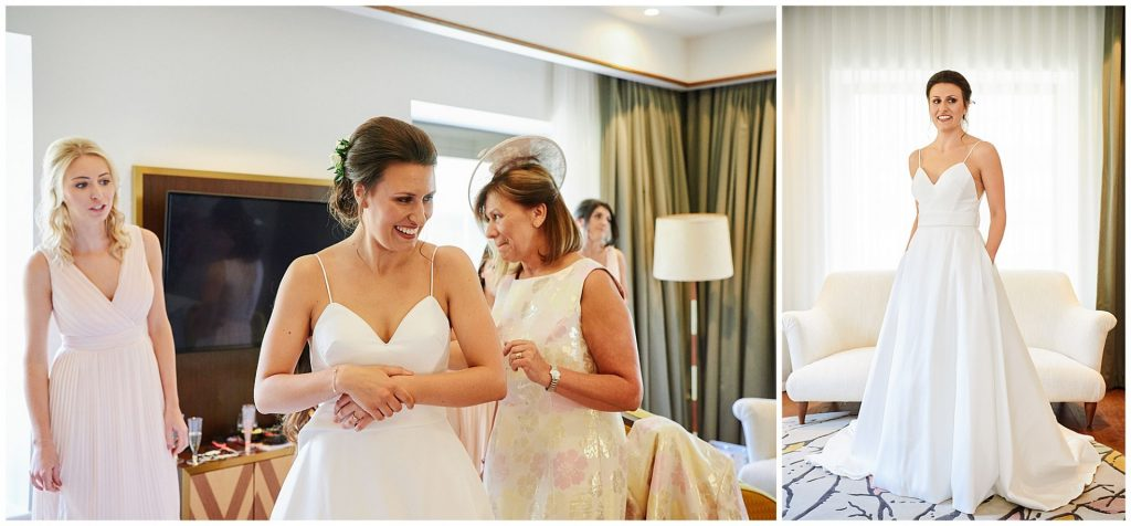 Bride posing in her wedding dress and smiling in hotel room in London
