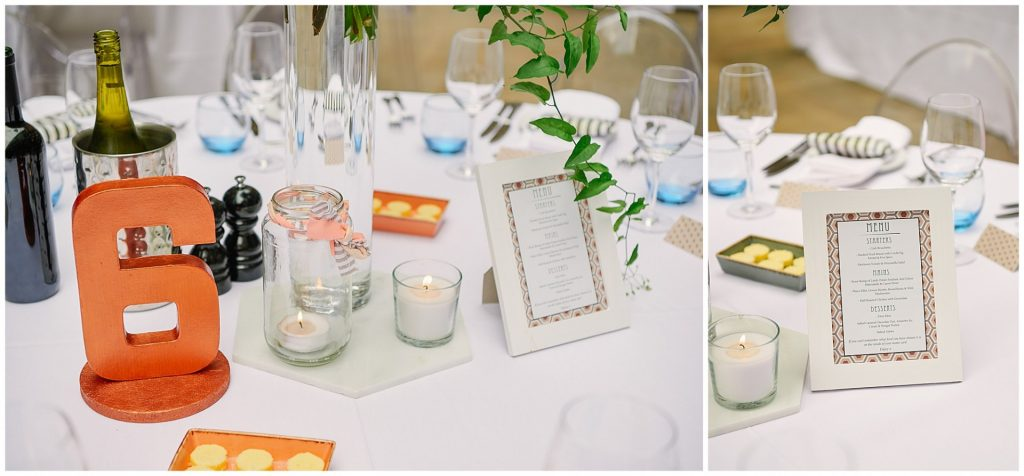 Wedding table details featuring candles, framed menu and table number at Devonshire Terrance in Central London.