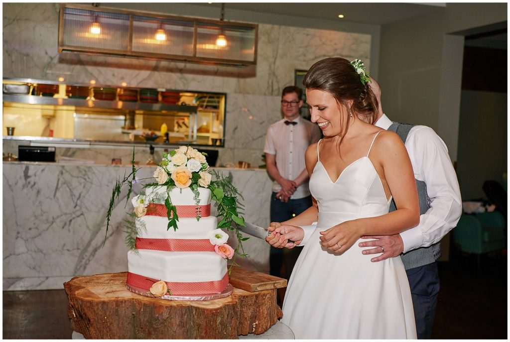 Bride and groom cutting the cake at Devonshire Terrance in Central London.