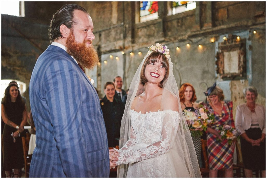 Alternative bride and groom smiling during their vintage wedding at The Asylum