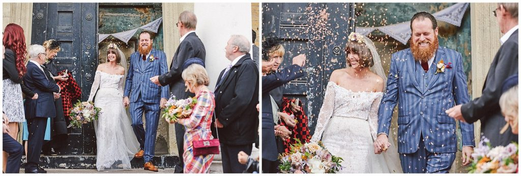 Bride and groom having confetti thrown at them whilst walking out of the Asylum in Peckham.