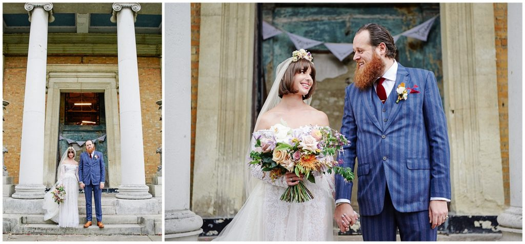 Bride and groom holding hands in front of an old decaying church in London.