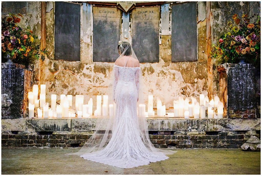 Alternative vintage bride stood in the decaying Asylum wedding venue in Peckham