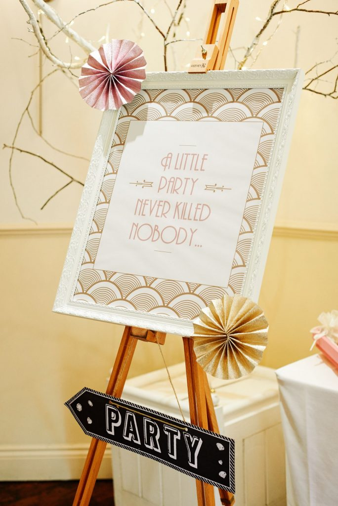 Great Gatsby style wedding party sign with gold and pink fans