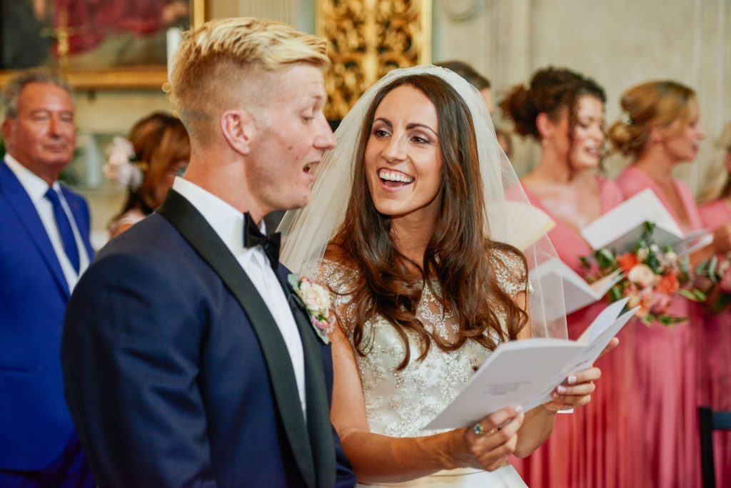 Bride and groom singing hymns during their Italian destination wedding ceremony