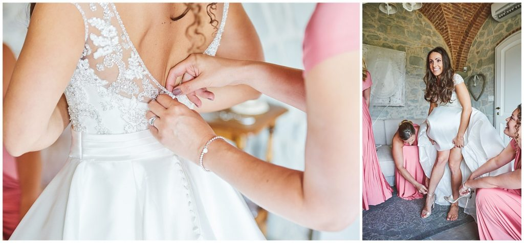 Bride laughing whilst her bridesmaids help put on her wedding dress at Villa le Fontanelle