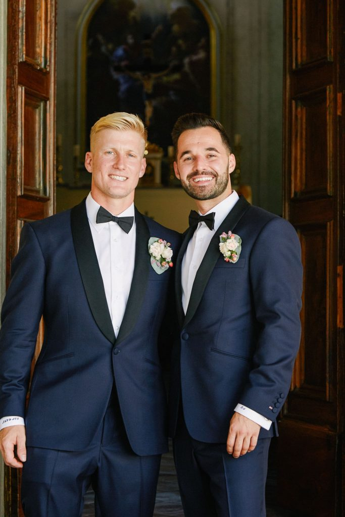 Groom and groomsmen smiling outside of the Catholic Church of Careggi in Florence, Italy