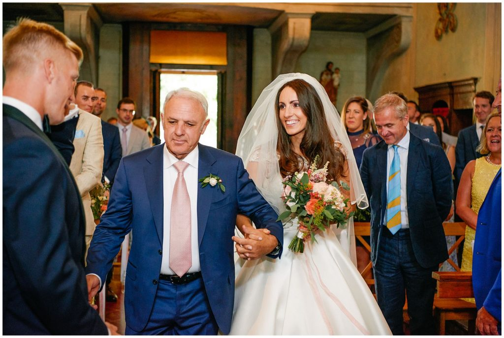 Brides and her father walking down the isle at the Catholic Church of Careggi in Florence, Italy