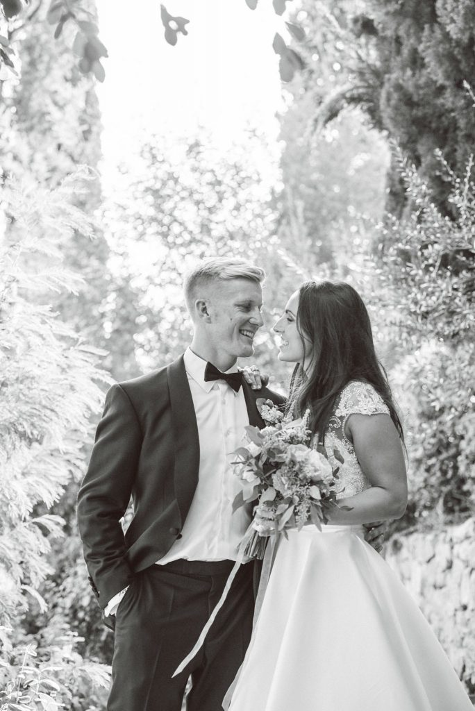 Bride and groom laughing together at the villa le Fontanelle in Florence Italy