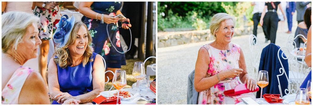 Wedding guests laughing and socialising at the villa le Fontanelle wedding venue in Florence, Italy