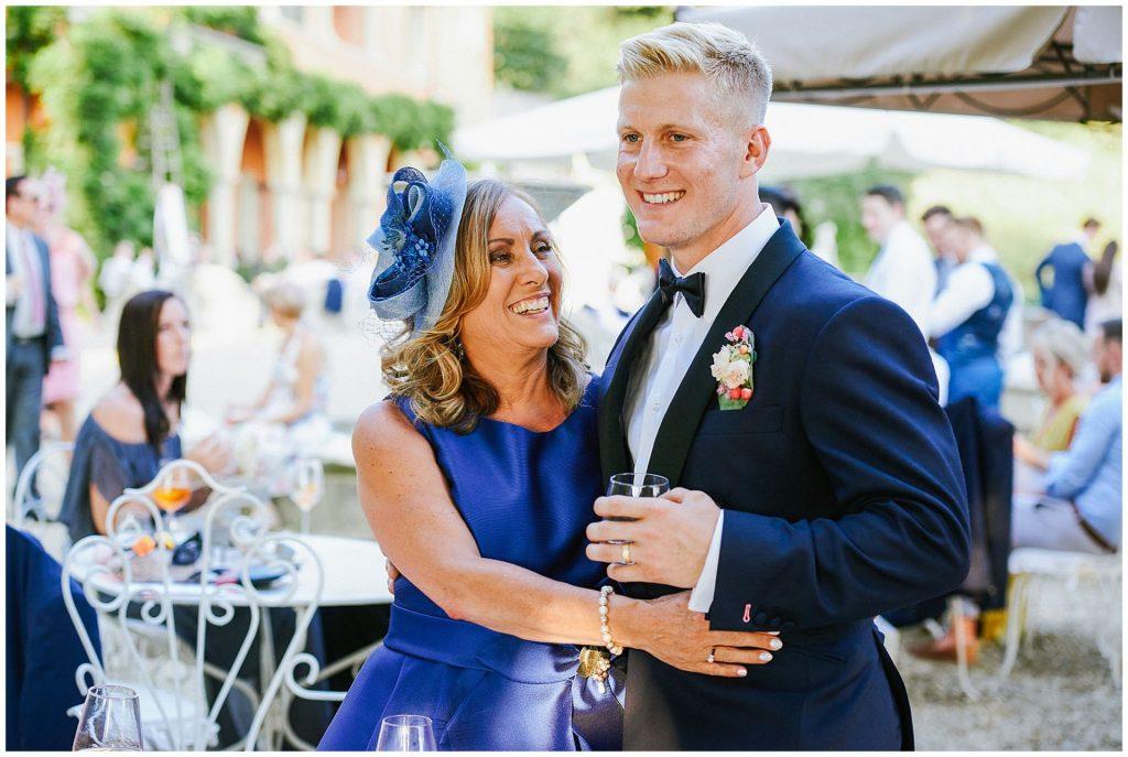 Grooms mum hugging him during outdoor reception at Italian Destination Wedding
