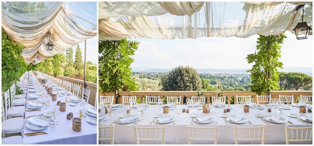 outdoor empty wedding table set up overlooking a stunning view of Florence