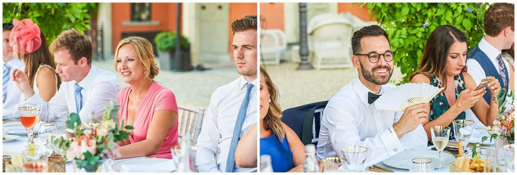Wedding guests sat outside at dinner overlooking a stunning view of Tuscany at Villa Le Fontanelle in Florence, Italy.