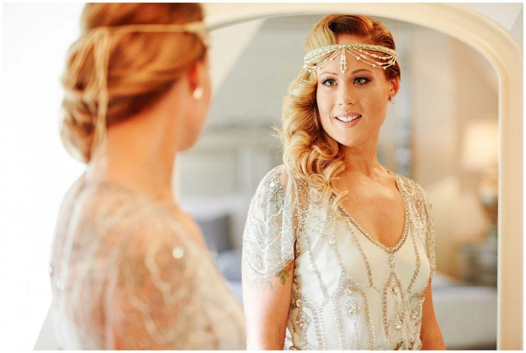 Glamorous vintage bride wearing lace and gold sequined Jenny Peckham wedding dress