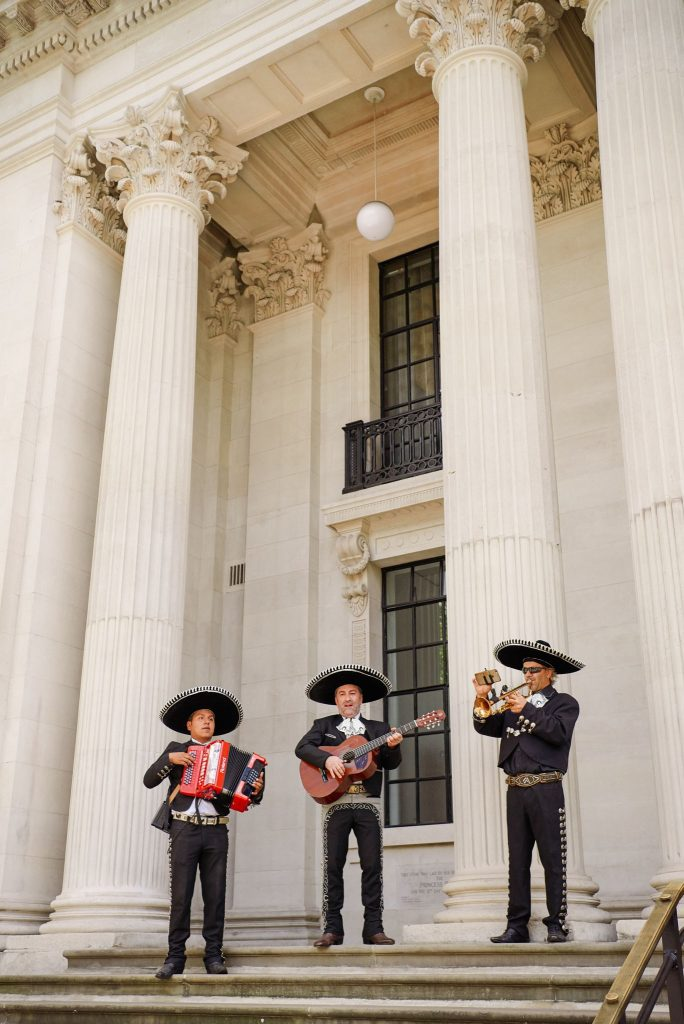 Mexican mariachi band playing outside of The Old Marylebone Town Hall on wedding day
