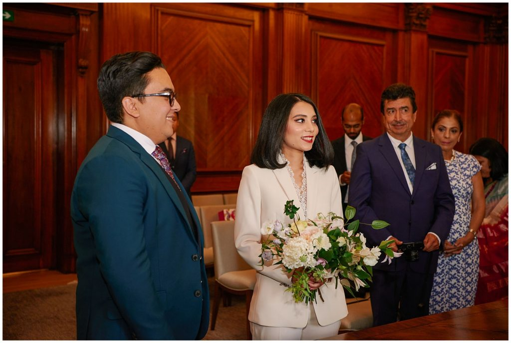 Bride and groom stood at the alter during their ceremony at Old Marylebone Town Hall