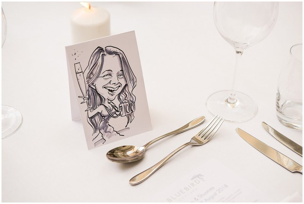 Caricature wedding guest favour on a white table at the Bluebird in Chelsea, London