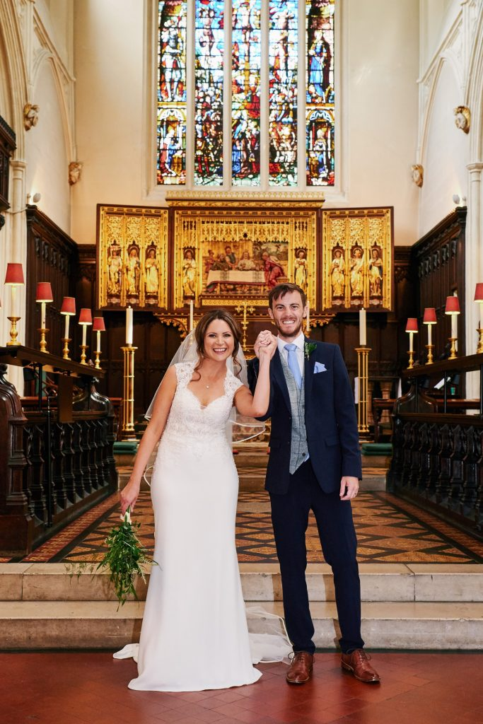 Bride and groom smiling together after getting married in St Margret's Church in London