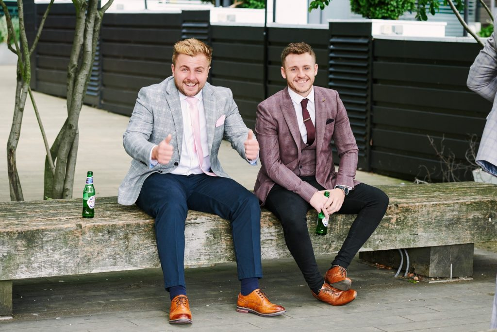 Wedding guests sat drinking beer outside of The Oyster Shed in London