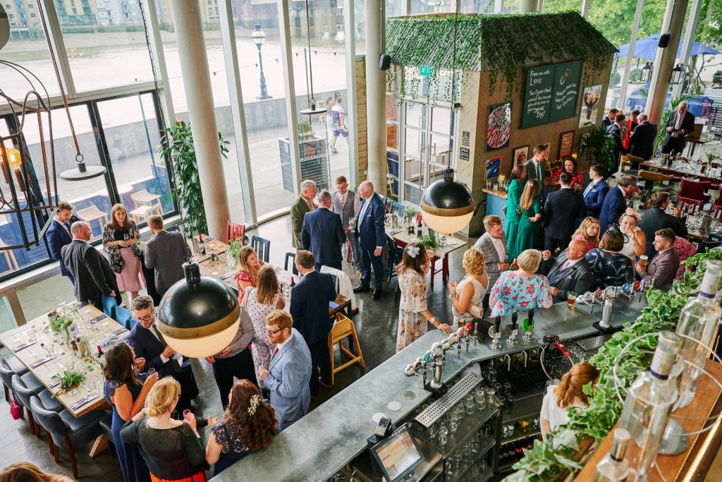 Wedding guests socialising at the The Oyster Shed in London City