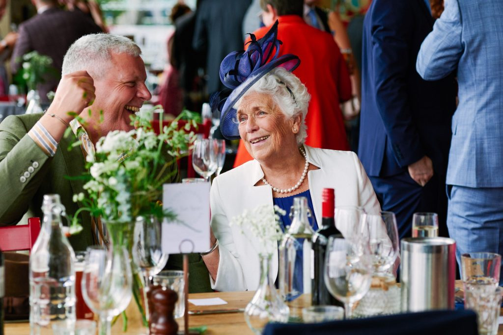 Old couple laughing whilst at a wedding reception at The Oyster Shed