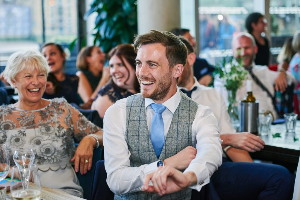 groom laughing during wedding reception at The Oyster Shed