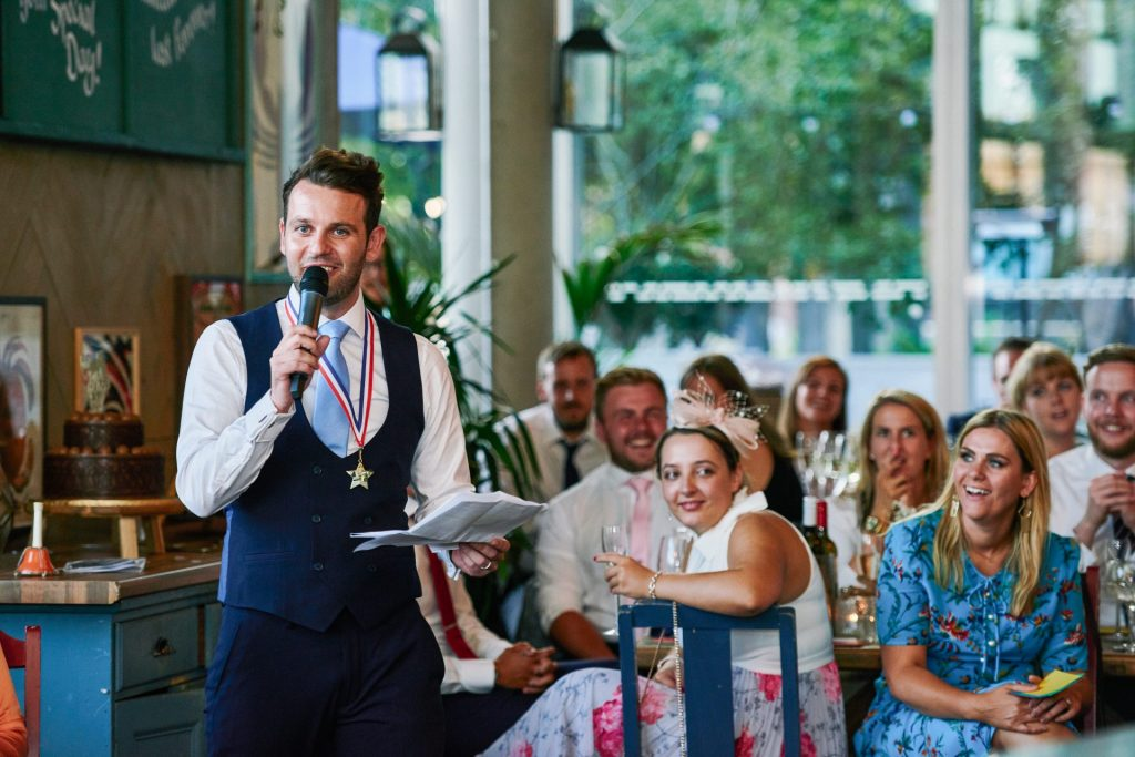 Usher giving a speech during wedding reception at The Oyster Shed