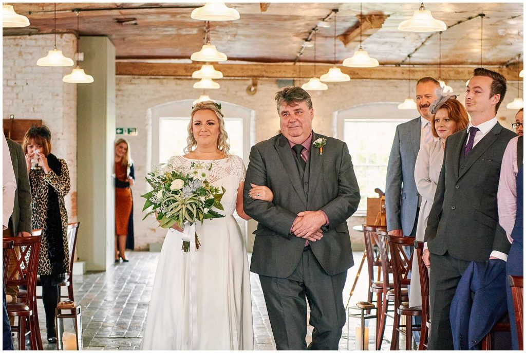 Bride and her father walking down the isle at the West Mill Wedding Venue in Derby