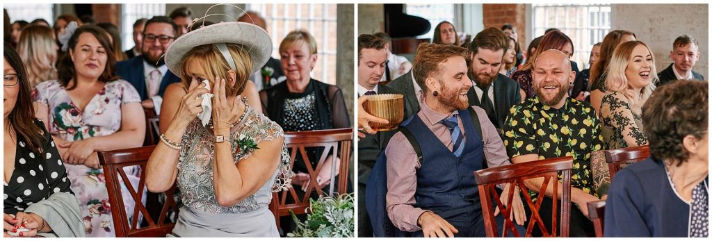 Wedding guests crying and laughing during ceremony at the industrial looking West Mill Venue in Derbyshire
