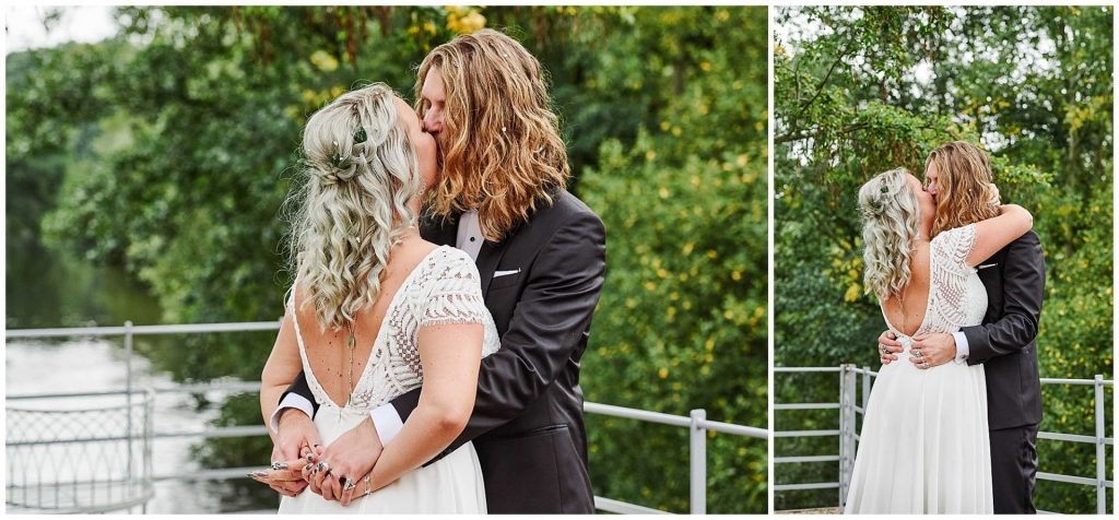 Rock and Roll style Bride and groom kissing outside in front of green trees at the West Mill Wedding Venue in Derby