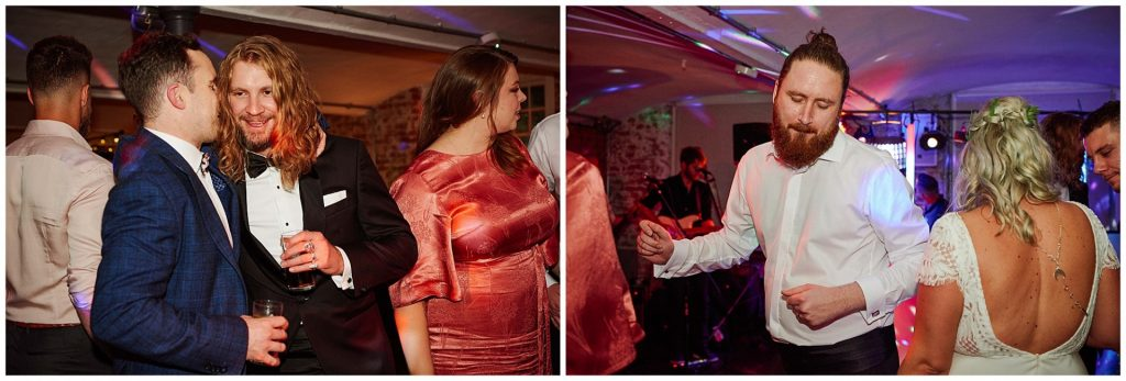 wedding guests having fun and and dancing during the evening reception at The West Mill Wedding Venue in Derby.