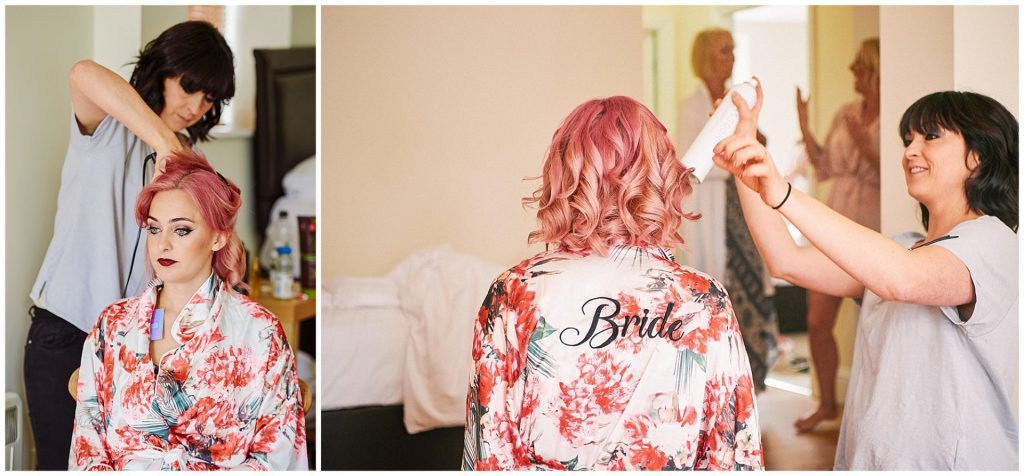 Rock n roll style bride having her pink hair styled