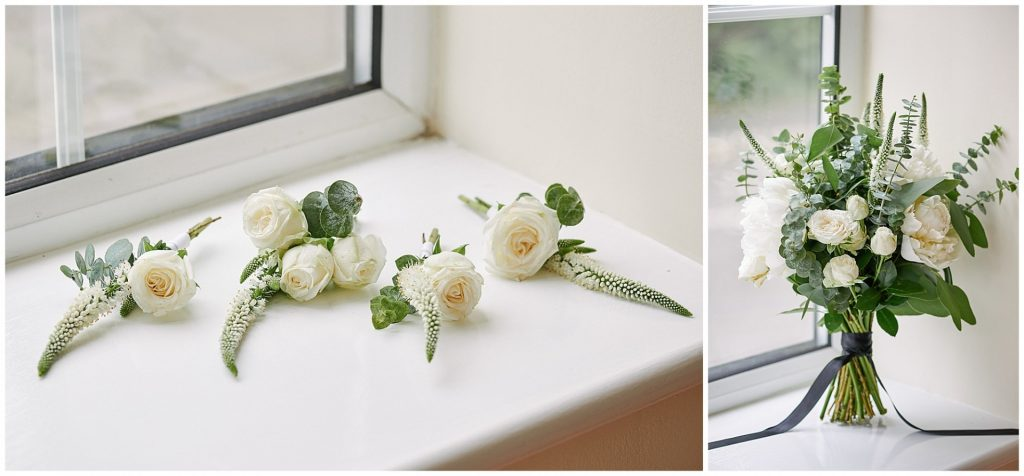 White and green wedding flowers on a window ledge