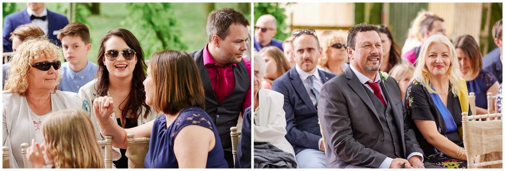 Wedding guests sat smiling during an outdoor wedding ceremony at The Pheasantry Brewery.