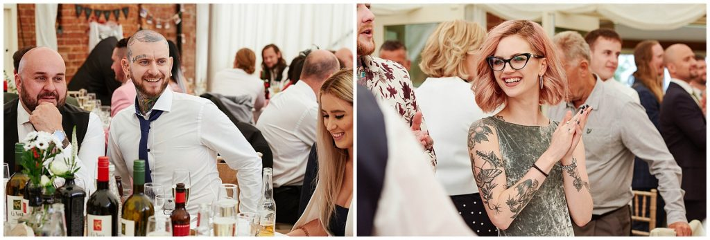 Tattooed wedding guests laughing during rock n roll wedding dinner