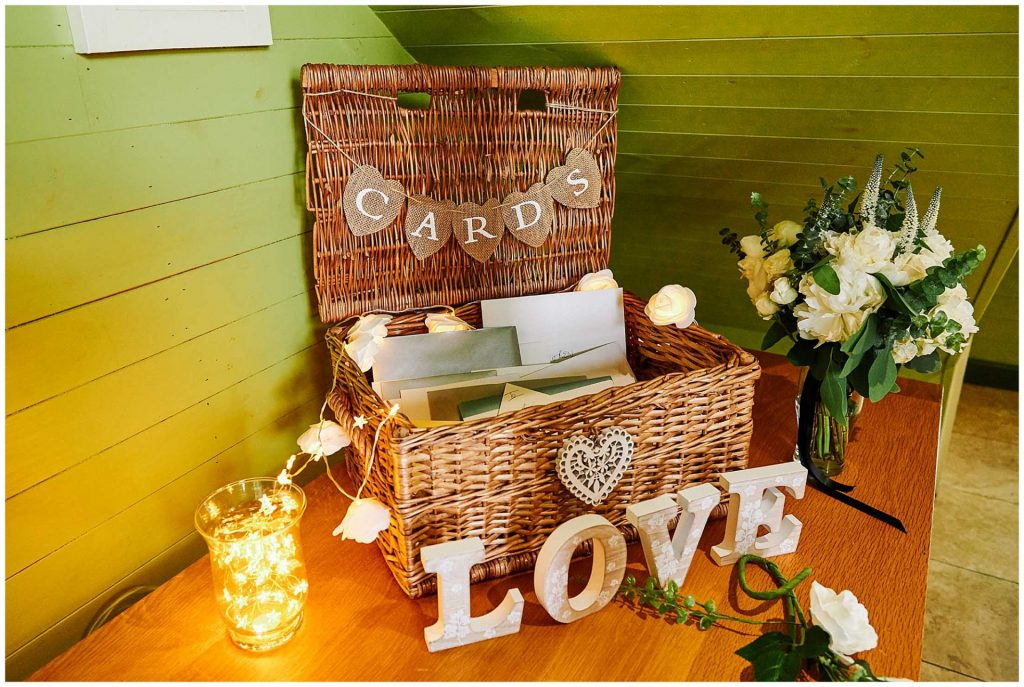 wedding cards and gifts in a basket