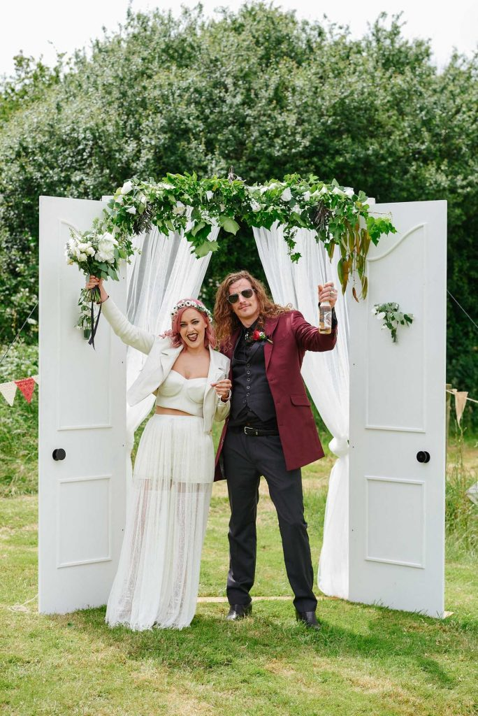 Bride and groom celebrating together at their festival style wedding