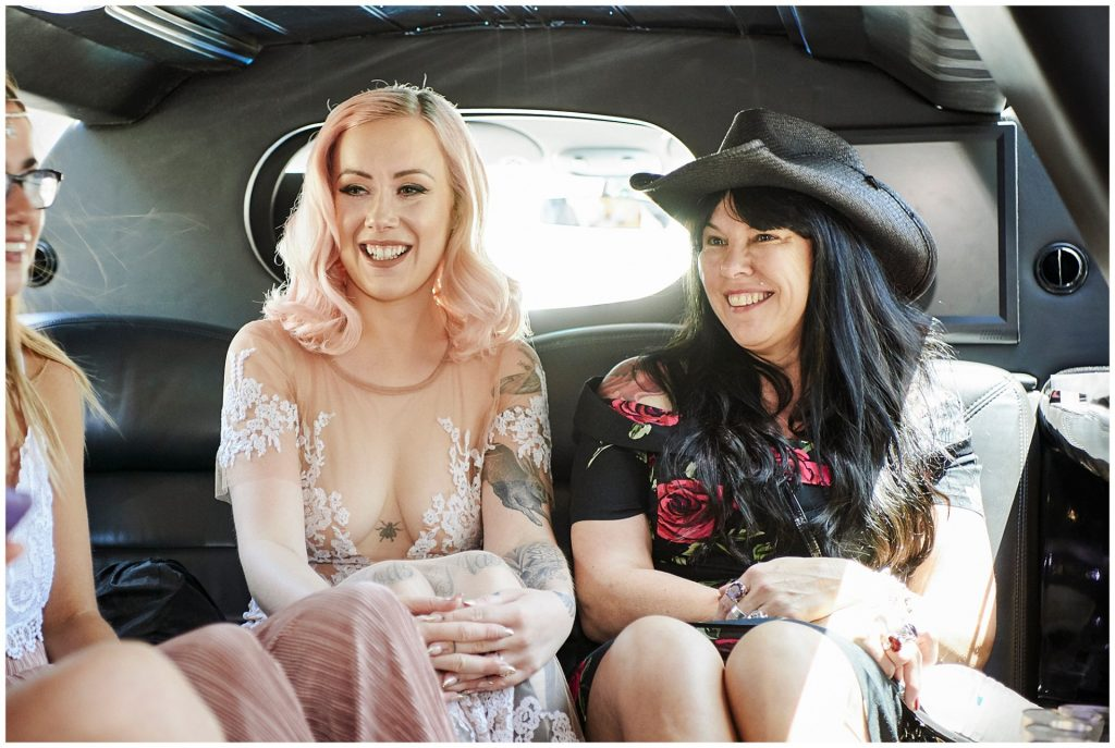 Rock n Roll bride in wedding car with her mum.