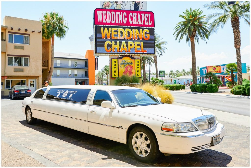 Limousine parked outside the wedding chapel venue.