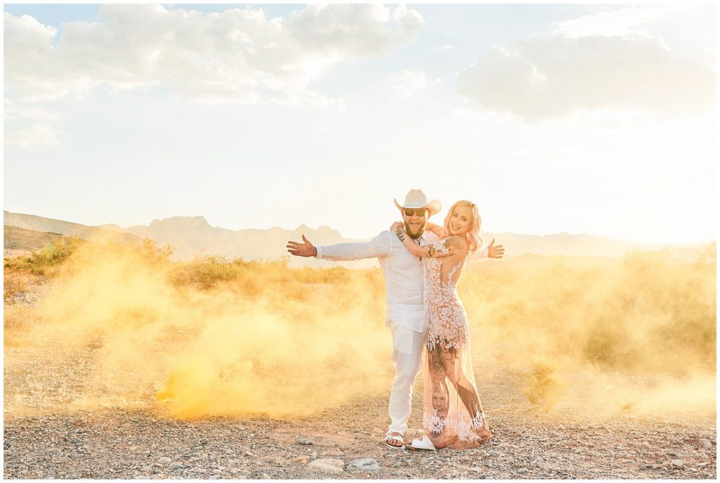 Alternative bride and groom smiling in the Las Vegas desert during destination wedding