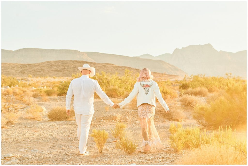Rock n roll wedding couple walking through yellow smoke in Las Vegas desert