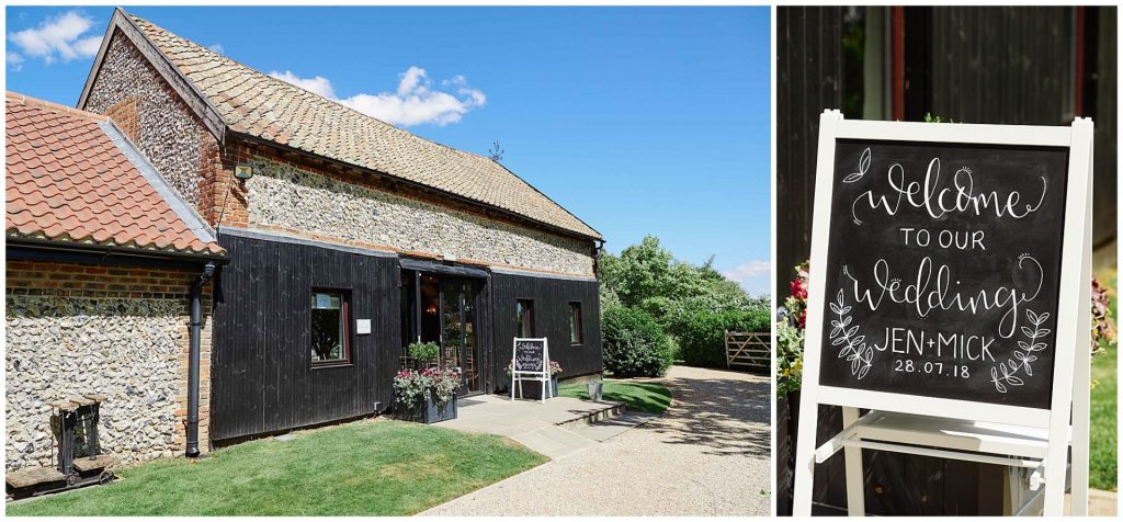 Exterior of The Granary Estates in Cambridge on a sunny day with a black welcome wedding sign.