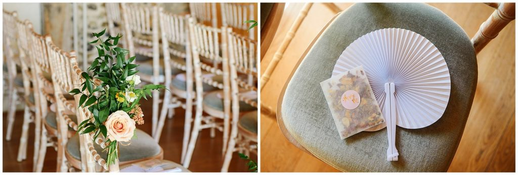 Wedding flowers, fans and confetti details in the ceremony room at The Granary Estates barn in Cambridge
