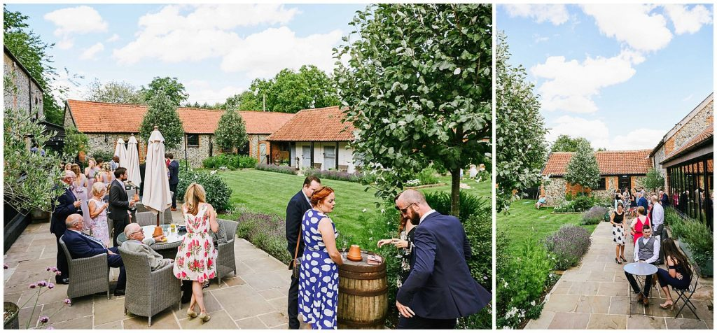 Wedding guests socialising on a sunny day at The Granary Estates barn in Cambridge.