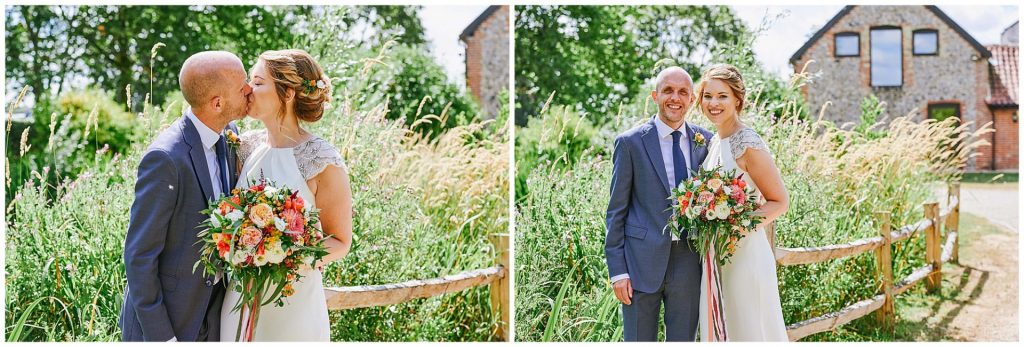 Bride and groom kissing in the sunshine at The Granary Estates barn in Cambridge.