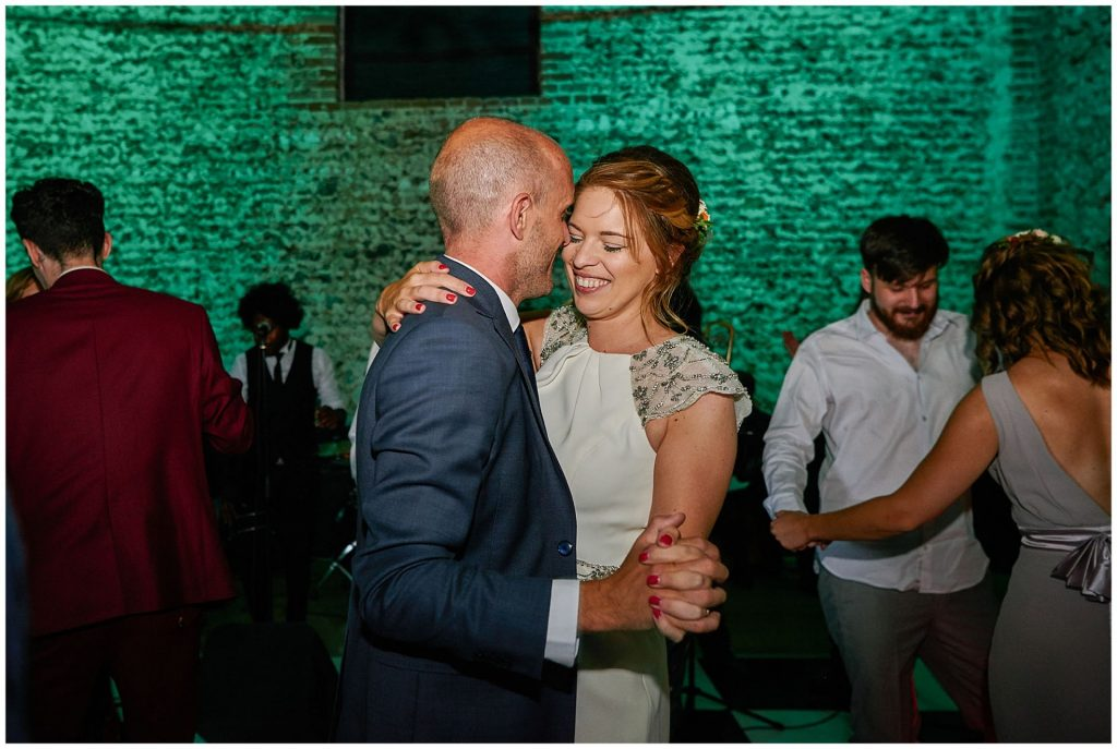 Bride and groom dancing together during their reception at the Granary Estates